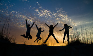 Happy jumping silhouettes